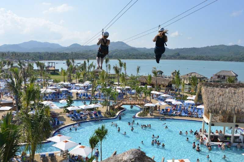 Ziplining in Amber Cove, Dominican Republic. Photo via Fathom Travel