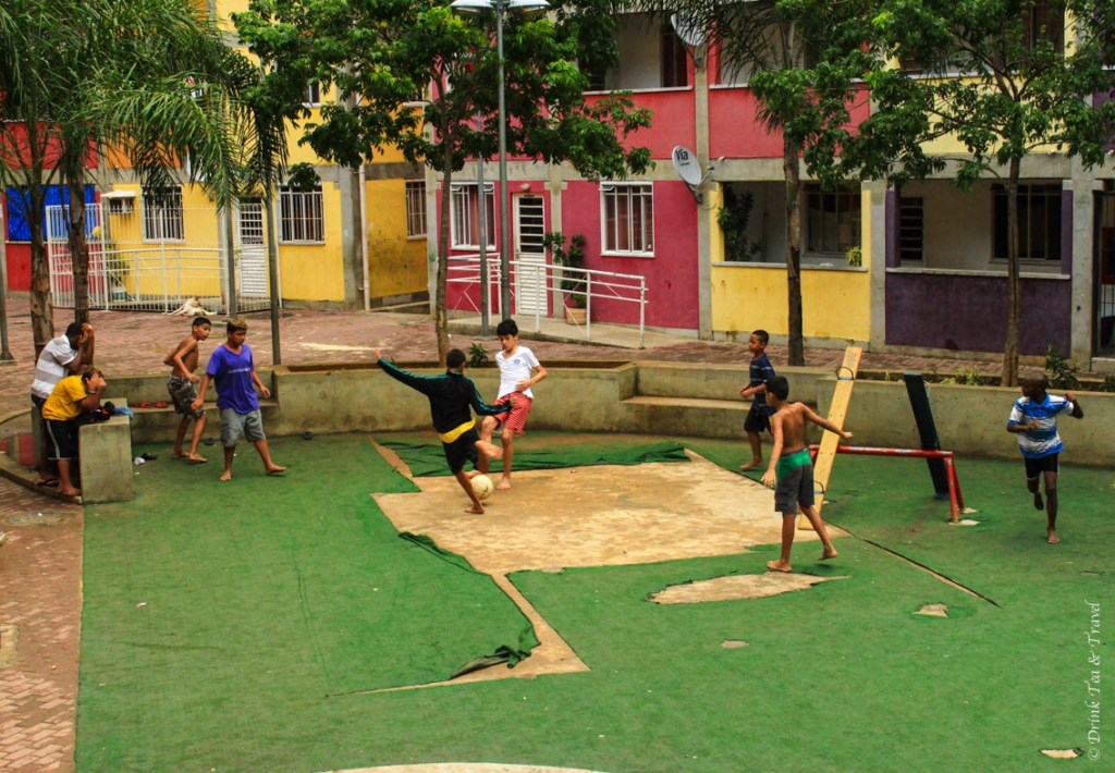 Kids playing football on the street in Rocinha, largest favela in Rio de Janeiro
