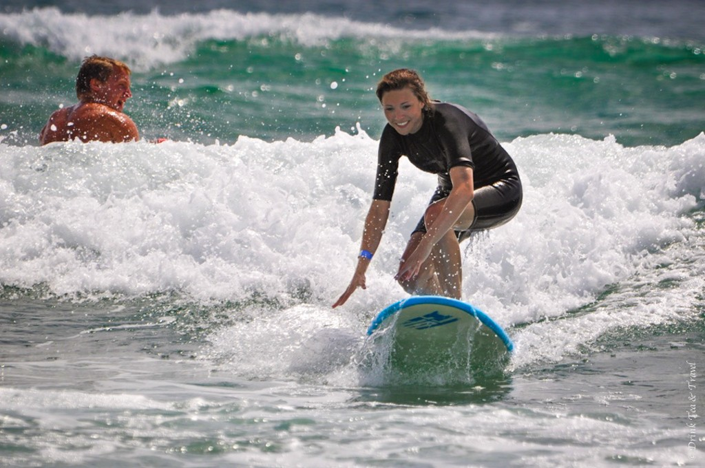 Catching a wave at Spot X Surf Camp, NSW. Australia