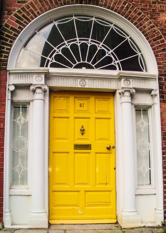 Yellow Georgian style door in Dublin