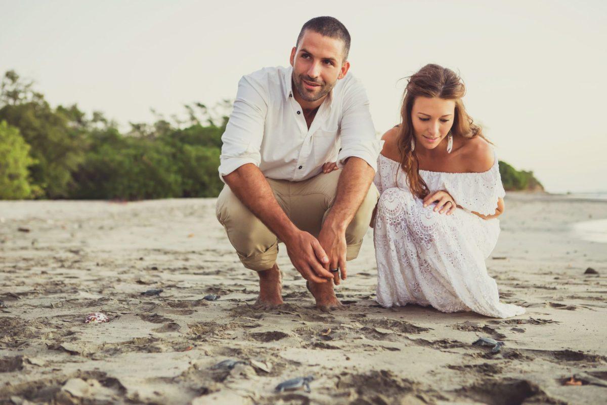 Max and Oksana with baby turtles on Playa Lagartillo. Costa Rica