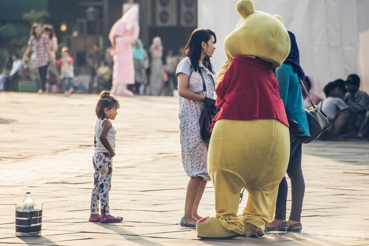 Winnie the Pooh chatting away with the locals in Taman Fatahilah, Old Jakarta