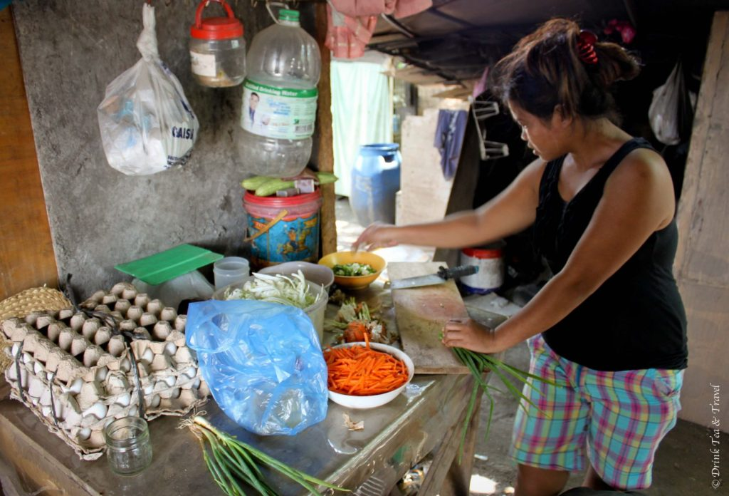 Cooking lunch at a dumpsite in Liloan, Cebu, Phlippines