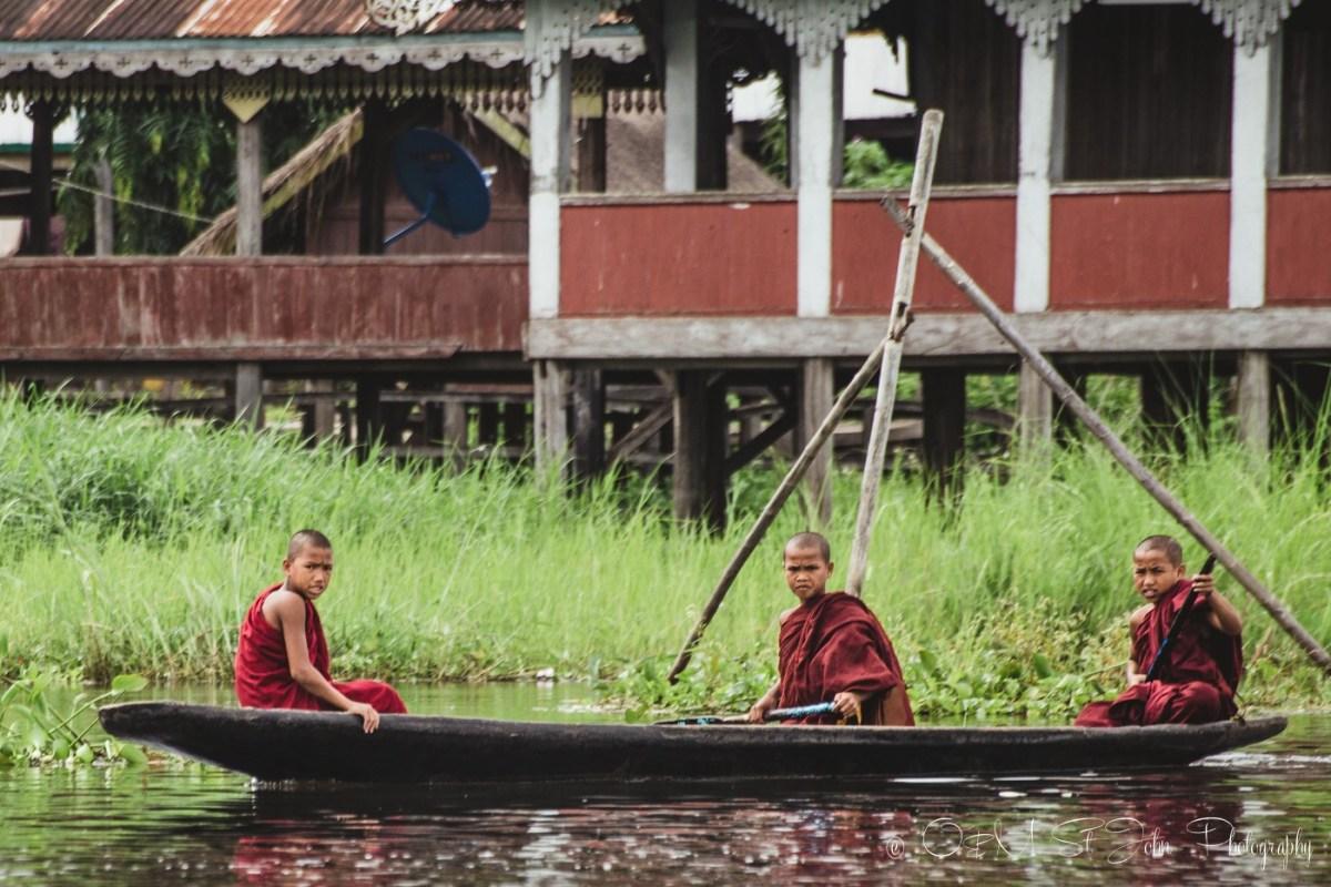 Young monks sailing on Inle Lake. Myanmar