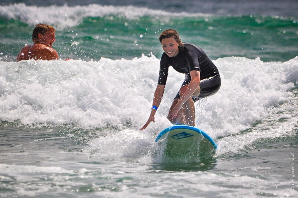 Catching my first wave at a surf camp in Australia