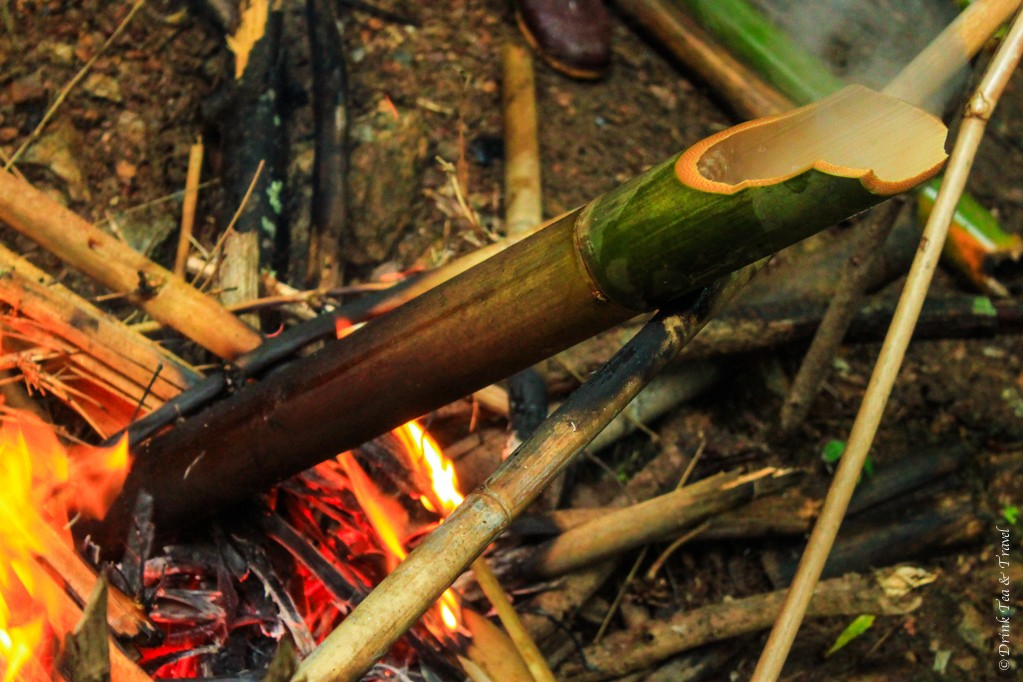 Water boiling in a hollowed out bamboo trunk