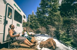 Max & Oksana having lunch near camper van in Colorado. USA Road trip