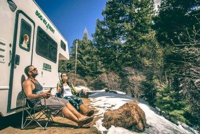 Max & Oksana having lunch near camper van in Colorado. USA Road trip