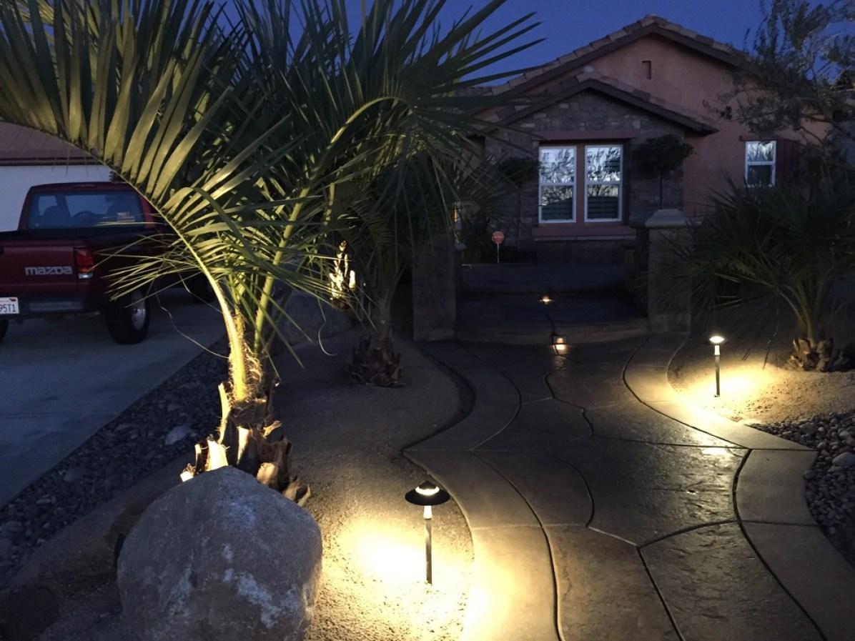 Outdoor lights illuminating landscape.