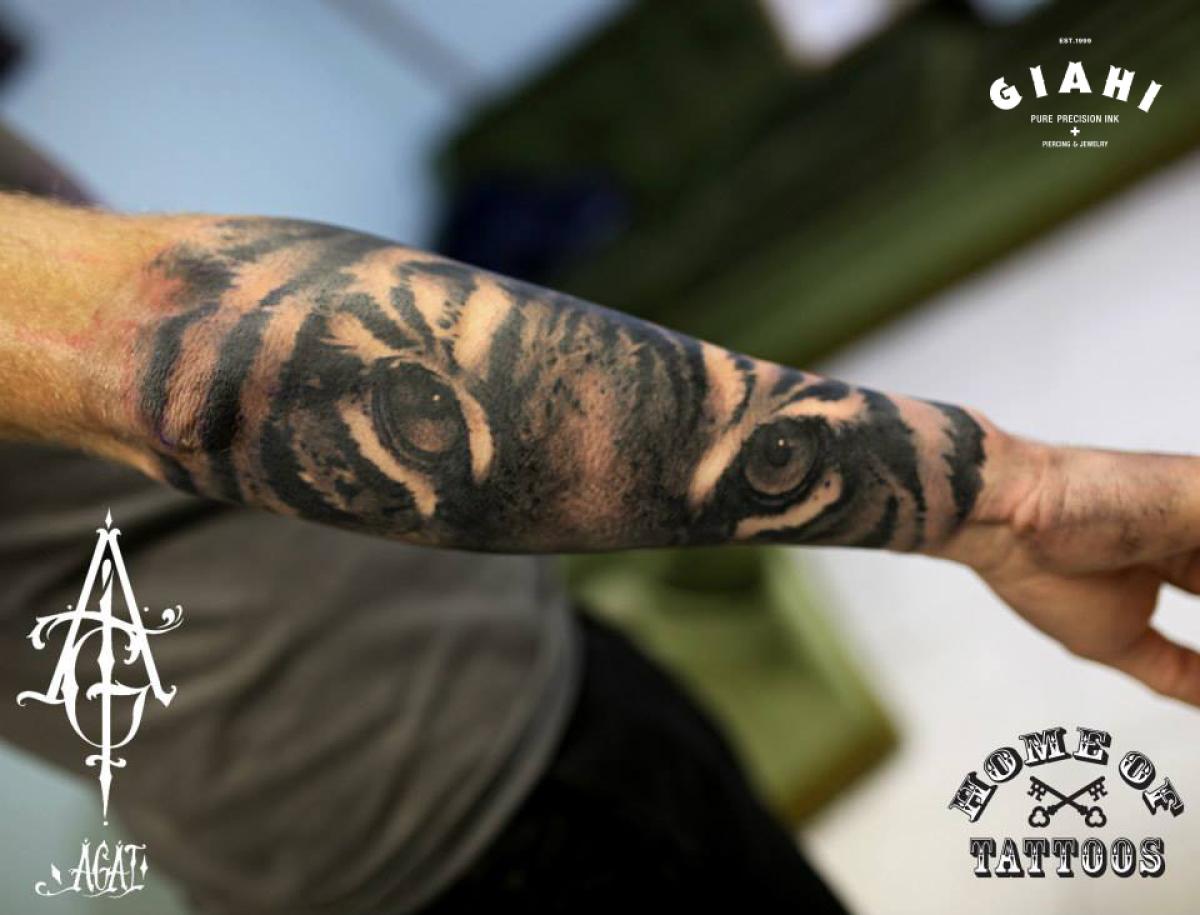 Arm tiger eyes tattoo by agat artemji best tattoo ideas for Tiger forearm tattoo