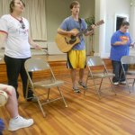 David Sittser (guitar) leads participants Page Crow and Tommy Preston in a music lesson and worship songs. (Staff photo by Leslie Ann Blake)