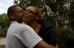 Shameka receives a kiss from her son Rhamir while they are playing around outside of Genesis.