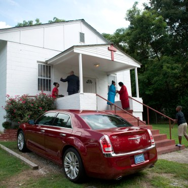 Members of the New Greater Zion Wall House of Miracles congregation gather for Sunday Worship on August 25, 2013. The close-knit Baptist church was founded in this East Durham neighborhood almost 63 years ago.