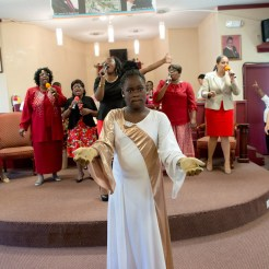 Serenity Teasley (center), 10, performs with the Praise Dancers during Sunday Worship at the New Greater Zion Wall House of Miracles while her mother, Robin Teasley (second from left), sings with the Praise Team. Serenity, like many of the youth active in the congregation, was born and raised in this tight-knit church community in East Durham.