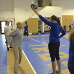TROSA resident Genna Vega (left) prepares to strike a ball held up by Duke volleyball player Alyse Whitaker. Vega, a TROSA resident whose niece played volleyball at Duke, participated in the Duke volleyball clinic on Jan. 31, 2014.