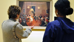 Ashley Weber takes a behind-the- scenes tour of the Archibald Motley exhibit at the Nasher Museum. The tour guide explains the significance of this painting of a black church. (Hillside Chronicle photo by Taquaisha Patrick)