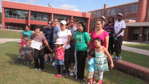 Twenty community members gather to kick off East Durham Children Initiative's six-week marathon event. Each resident will record the miles they've walked, receiving prizes along the way and a big one at the end. EDCI hopes this is a program that will allow neighbors to meet and support each other in being active. (Staff photo by Caitlin Ball)