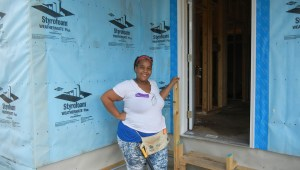 Prospective Habitat homebuyer and NECD native Quashun Capers helps to build her family's new home in NECD. (Staff photo by Mark Lihn)