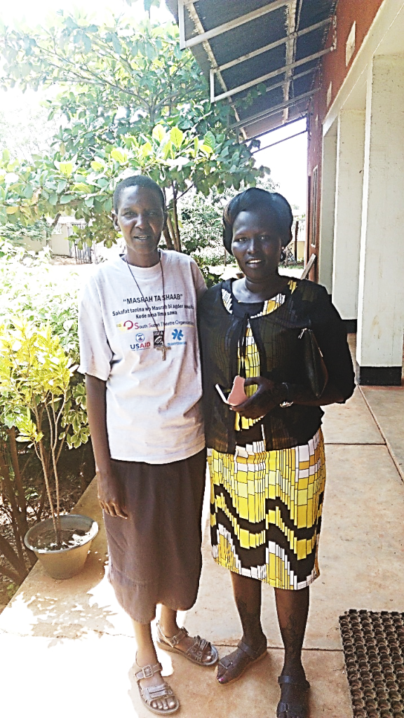 Julia Aluel Mario (right) is a successful midwife who attributes her success to the Wai Foundation mentoring program. She is seen here with our Tertiary Scholarship Administrator Sister Lily Grace Akedi (left).