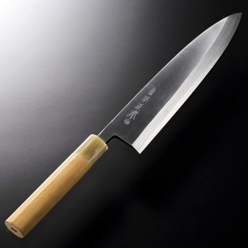 Los cuchillos de Tsukiji Masamoto se transmiten de generación en generación, Producto: Cuchillo Acero 2 Deba 210mm (afilable y mango reparable) Fabricante: Tsukiji Masamoto Material: Tipo de hoja de acero: Shiro-ko (White Steel 2) Material del mango: (Hō) Magnolia japonesa Material de refuerzo: cuerno de búfalo Precio aproximado: 275 €
