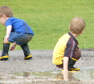 boys playing outside after rainstorm