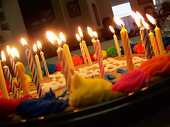 birthday candles sticking out of cake