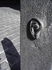 image of an ear sculpted into a wall