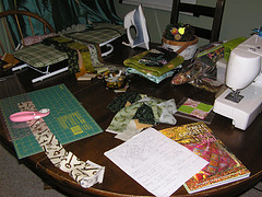 table with sewing machine, quilting supplies