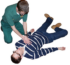 one man performing cpr on another