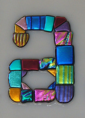the letter a made with mosaic glass
