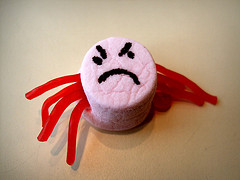 marshmallow with licorice legs and sad face painted on