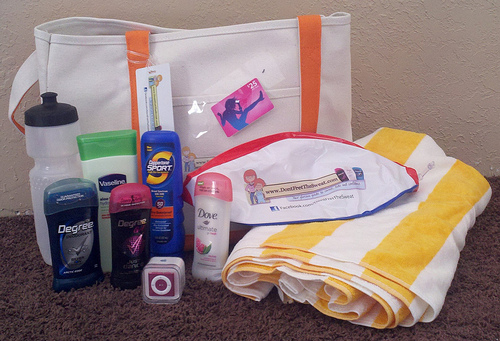 beach bag with deodorant, ipod, towel, beach ball, and itunes card