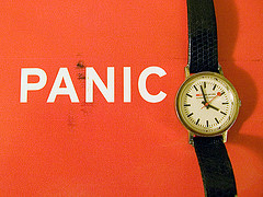watch on red background next to the word PANIC