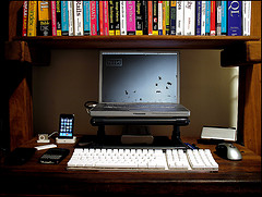 laptop computer sitting behind separate keyboard on desk