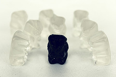 black gummy candy surrounded by clear candies
