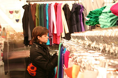 woman shopping for clothes in mall