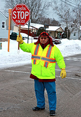 crossing guard holding up stop sign