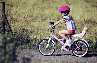 young child riding small bike