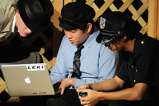 teen boys looking at laptop