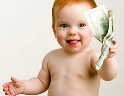 baby holding dollar bills