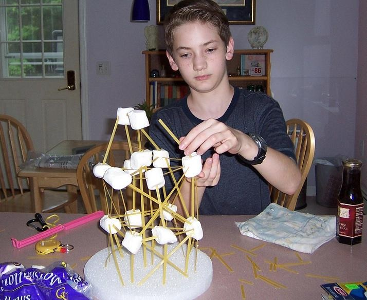 boy building structure