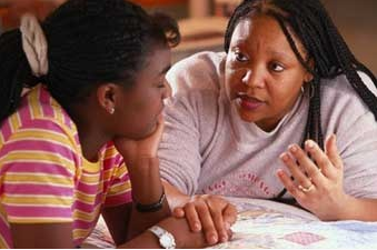 mother talking intently to daughter