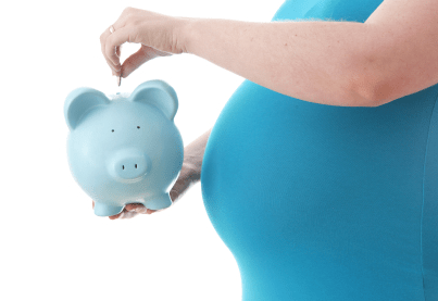 midsection of pregnant woman holding a piggy bank