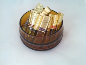 amber colored candy bowl holding Merci chocolates