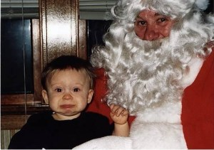 toddler looking scared by Santa