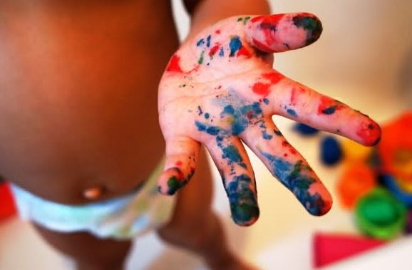 toddler's hands all splattered with paint