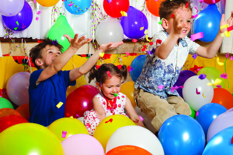 children jumping in a lot of balloons