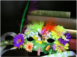 wildly decorated party hat with feathers, flowers, and toys