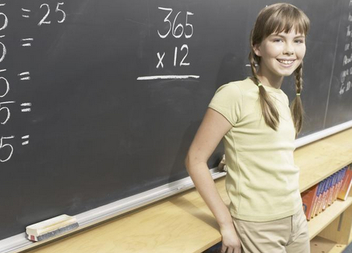 girl in front of chalkboard