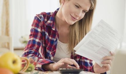 woman looking over bills